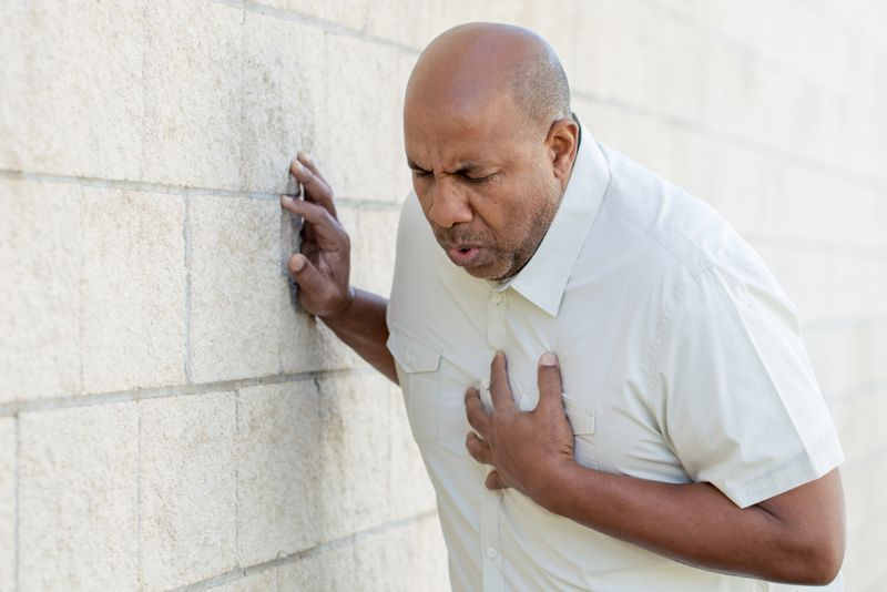 older man experiencing chest pain, heart attack symptom