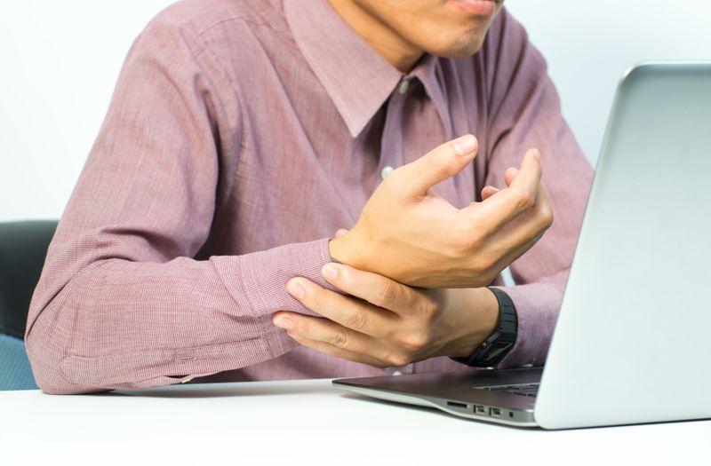 man sitting at desk has wrist pain