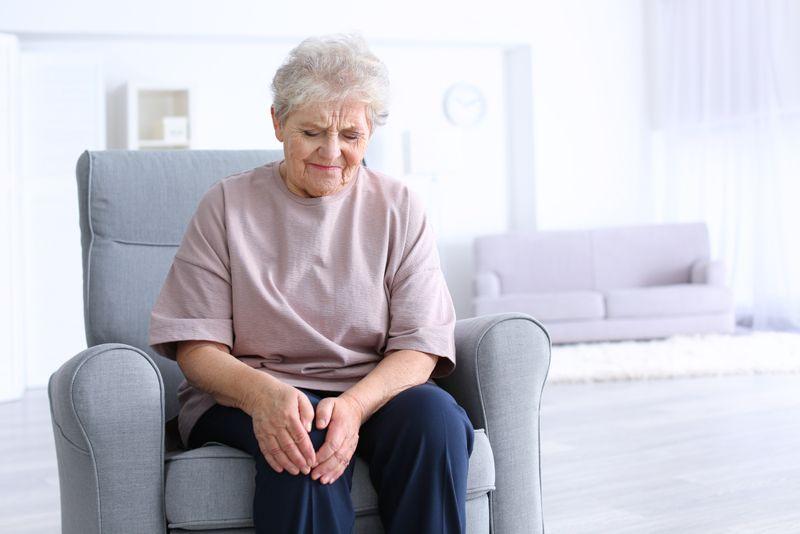 older woman has knee pain, osteoarthritis concept