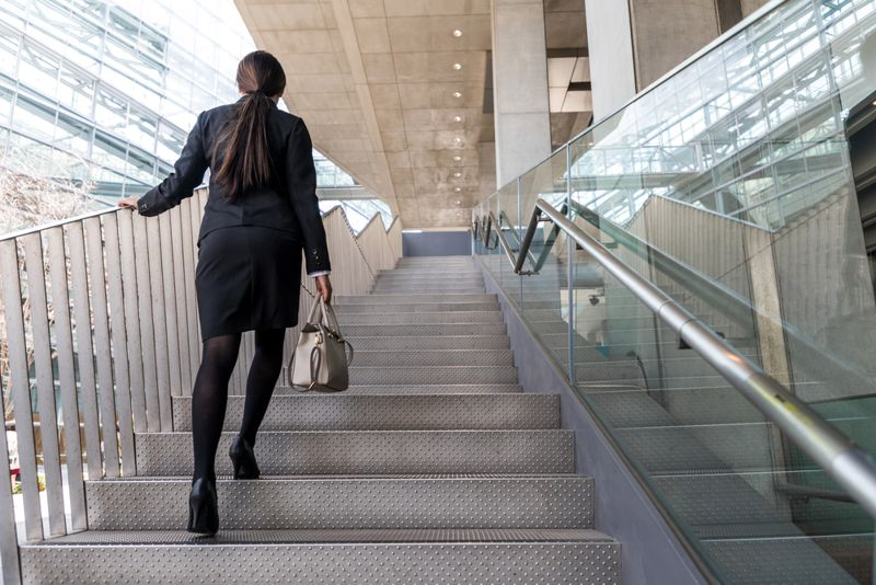 business woman taking the stairs in an office building