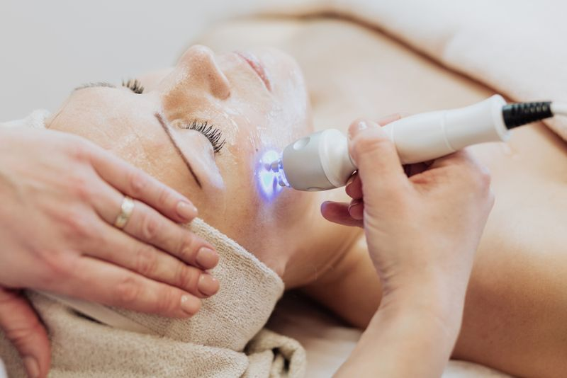 woman at spa getting laser skin treatment