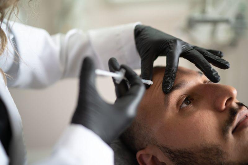 Man having filler injection