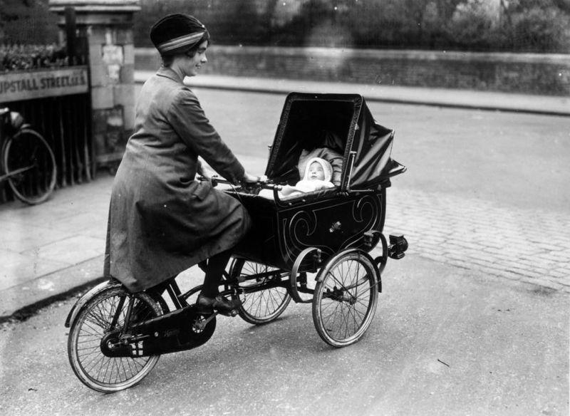 woman riding a cycle pram