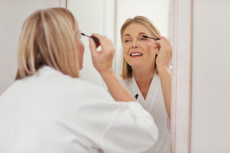 Woman with Mascara Brush