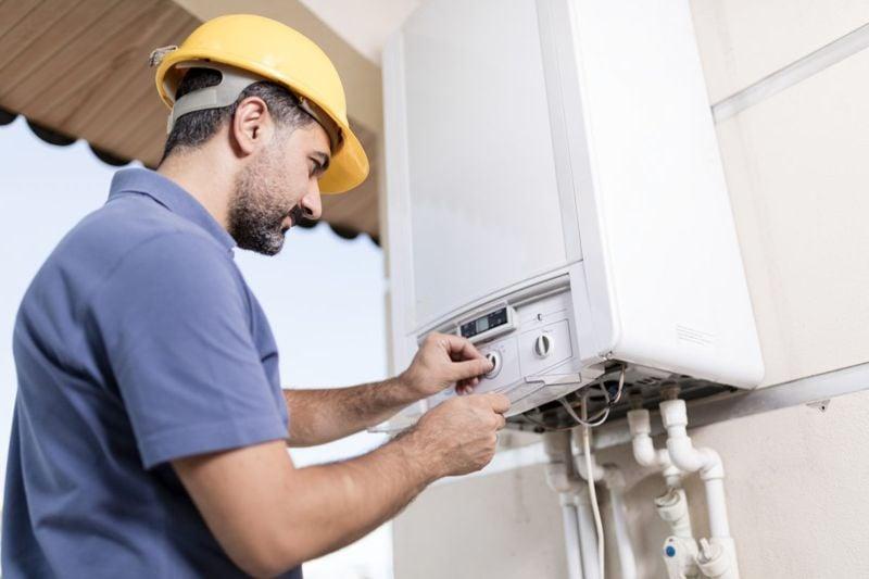 Man installing a water heater