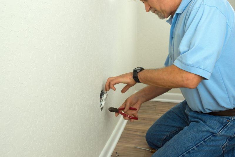 Man rewiring a socket