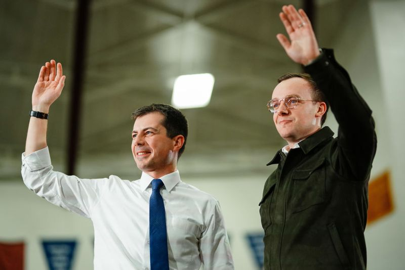 Pete Buttigieg, former mayor of South Bend and 2020 presidential candidate, left, waves to the crowd with his husband Chasten Buttigieg at a campaign event in Des Moines, Iowa, U.S., on Sunday, Feb. 2, 2020. Buttigieg's top campaign staff took veiled shots at Iowa front-runnersBernie SandersandJoe Biden, reflecting the candidate's argument that it's time for a fresh start in Washington.