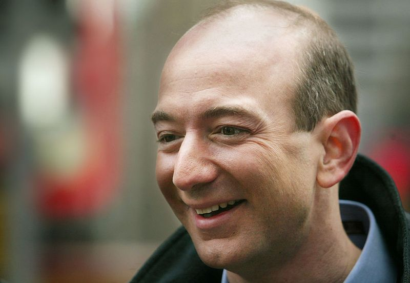 Amazon.com CEO Jeff Bezos smiles before opening the NASDAQ Stock Market November 18, 2002 in New York City. The electric-powered Segway transporter went on sale to the general public today and is available only at Amazon.com for $4,950.