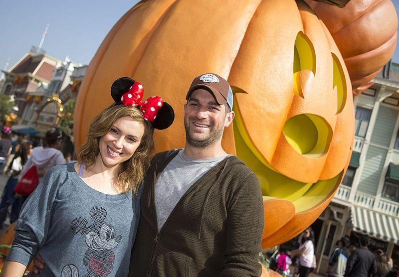 "ANAHEIM, CA - OCTOBER 26: Actress Alyssa Milano of television series""Mistresses"" and husband David Bugliari celebrate ""Halloween Time"" at Disneyland on October 26, 2013 in Anaheim, California."