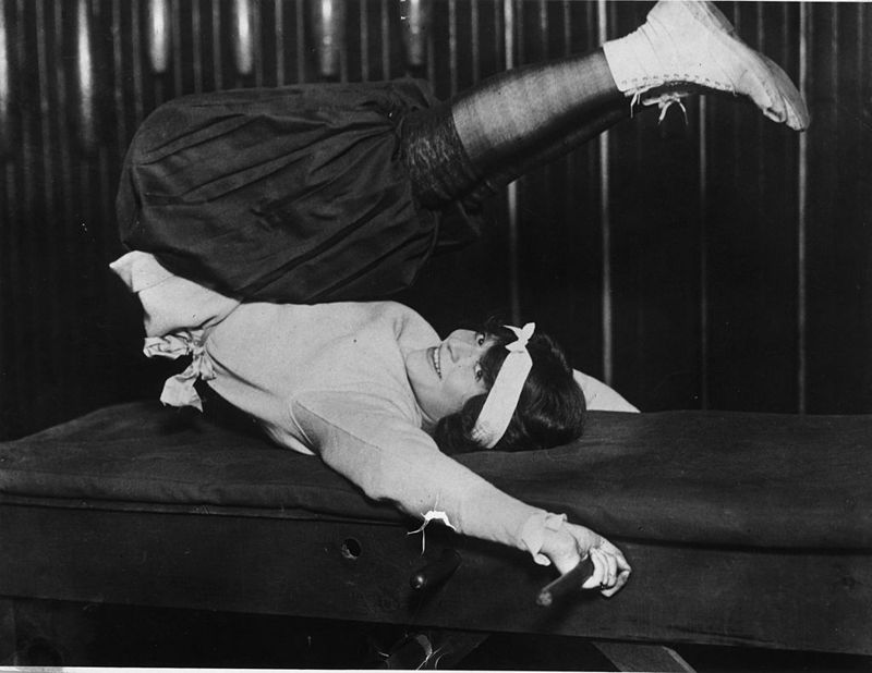11th April 1921: New York society hostess Mrs Edgar Leslie doing her daily exercises, wearing baggy knickerbockers.