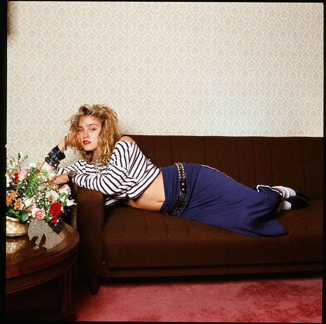 Madonna holding a fan in a hotel room, Tokyo, January 1985.
