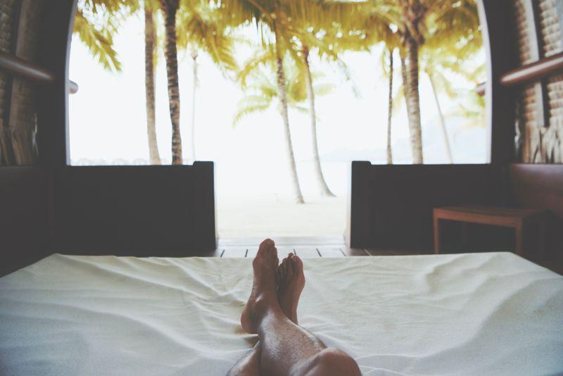 Relaxing feet in beach bungalo