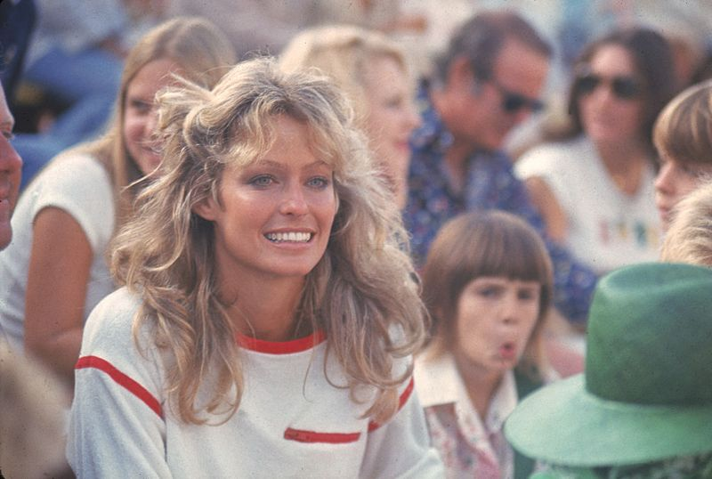 American actress Farrah Fawcett (then known as Farrah Fawcett-Majors) watches the on-court action at a Cedars-Sinai Medical Center charity tennis tournament, Hollywood, California, September 1976.