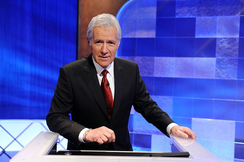 """CULVER CITY, CA - APRIL 17: Game show host Alex Trebek poses on the set of the """"Jeopardy!"""" Million Dollar Celebrity Invitational Tournament Show Taping on April 17, 2010 in Culver City, California."""