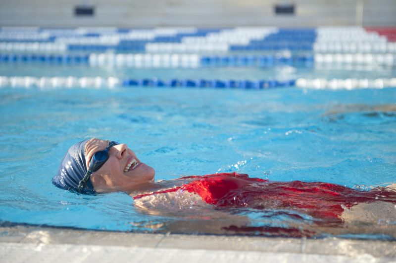 older woman swimming in a pool