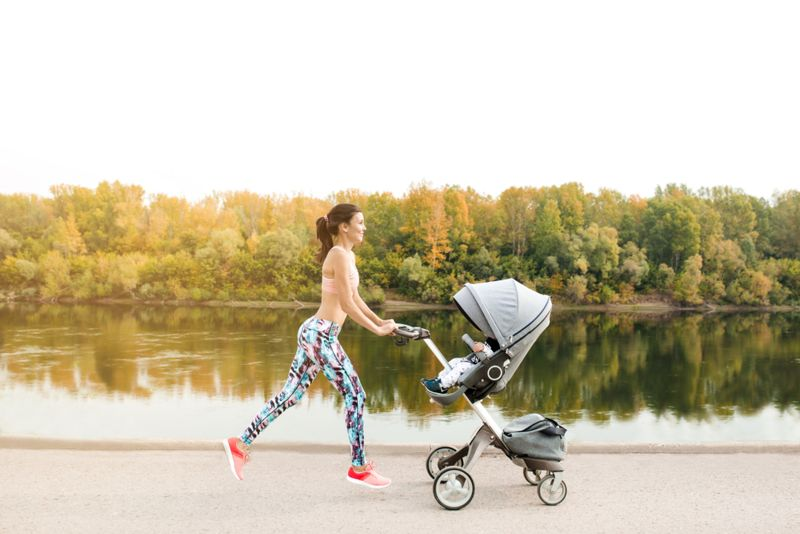 new mother jogging with baby in stroller