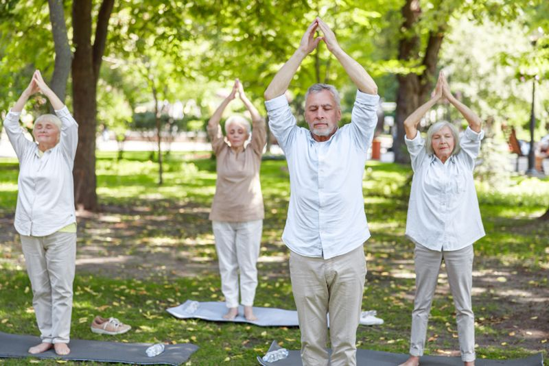 older adults doing tai chi in the park
