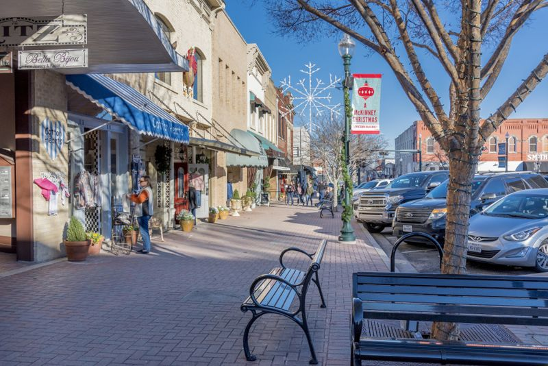 A beautiful view of the stores by a sidewalk captured in McKinney, Texas