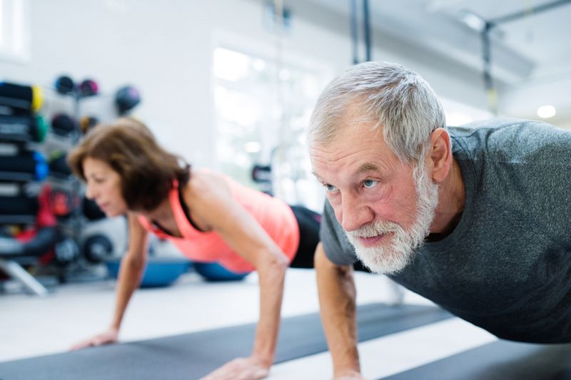 older adults doing pushups in fitness class