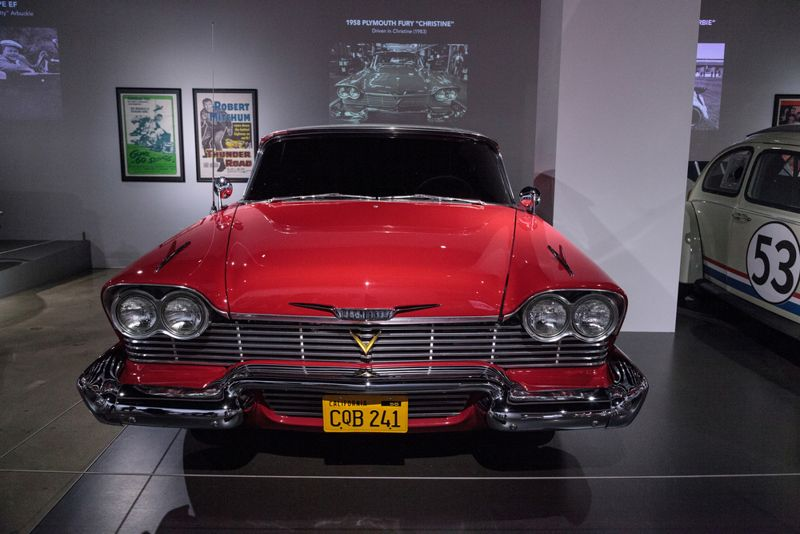 Red 1958 Plymouth Fury stunt car from the movie Christine at the Petersen Automotive Museum in Los Angeles, California
