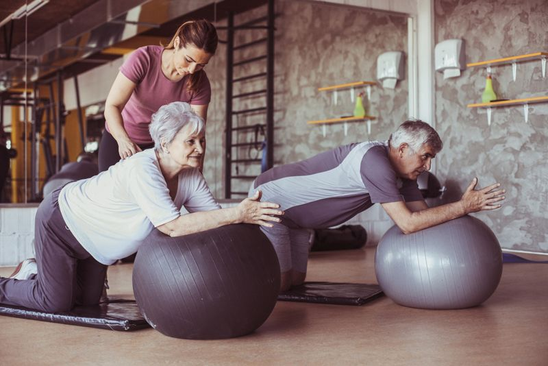 older clients at gym using exercise balls