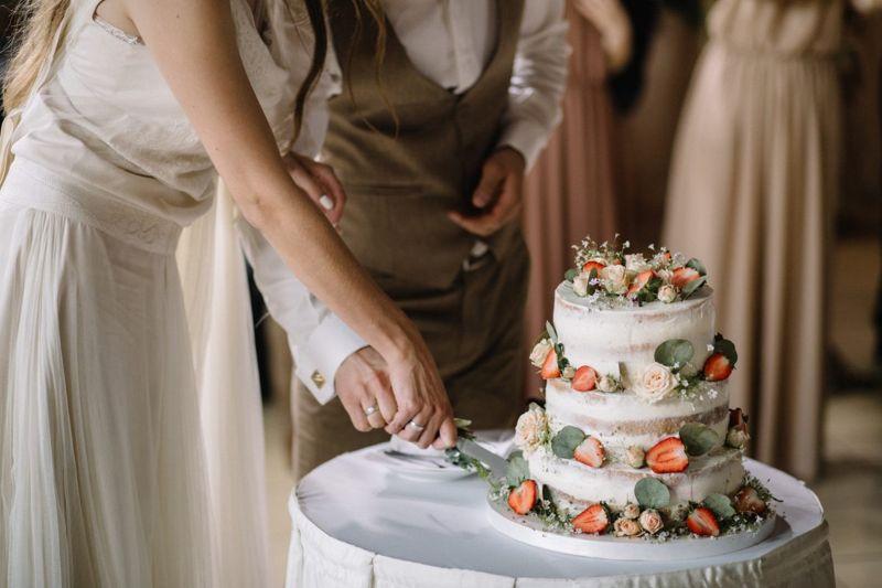Happy couple slicing the wedding cake