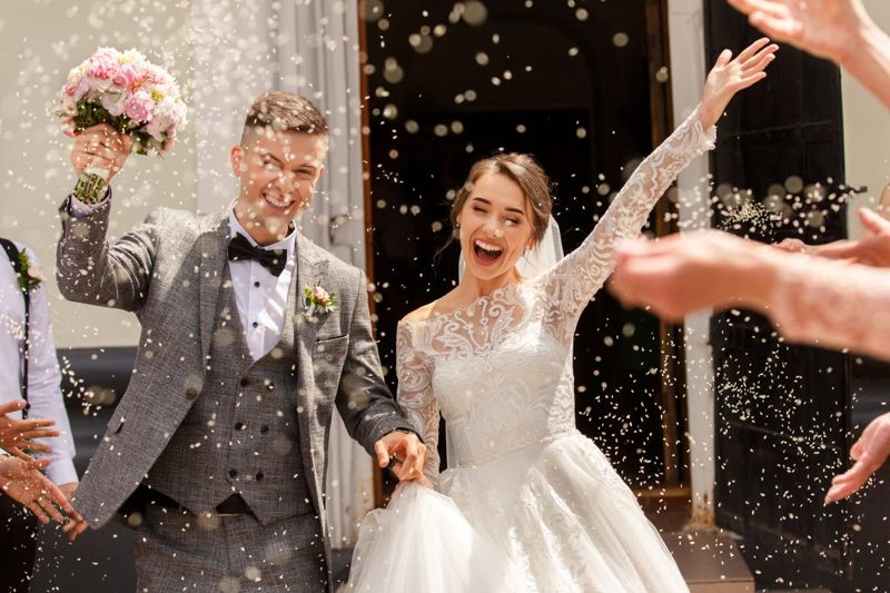 Bride and groom celebrating on their wedding day