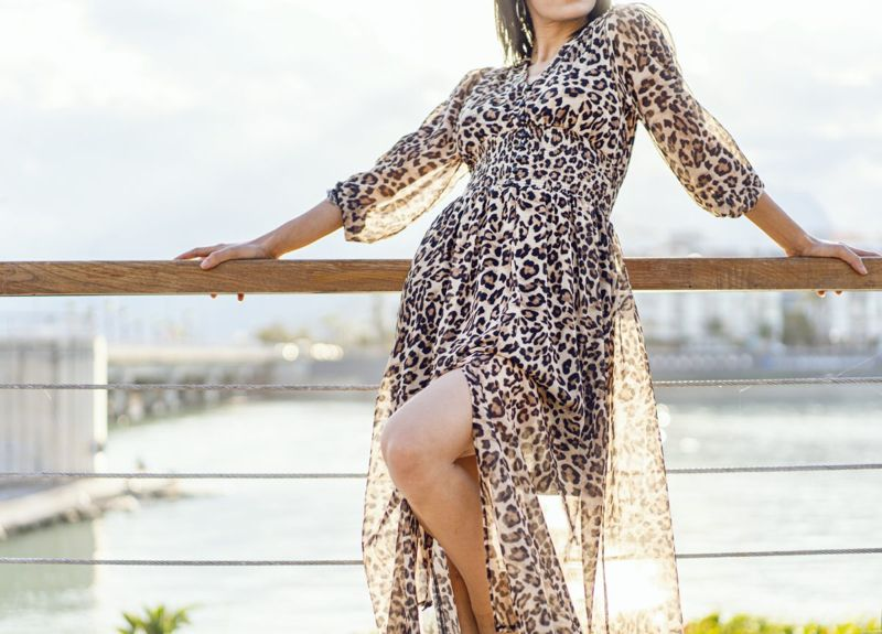 Woman wearing a leopard print dress
