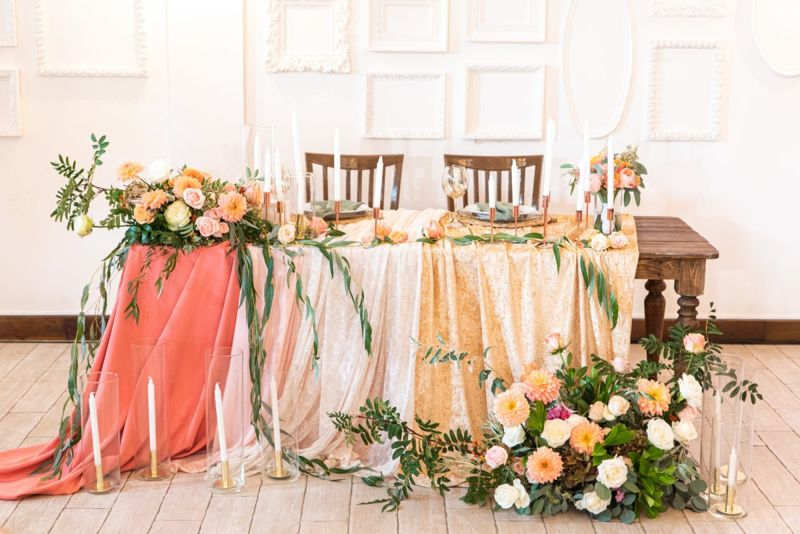 Wooden table surrounded by floral arrangements