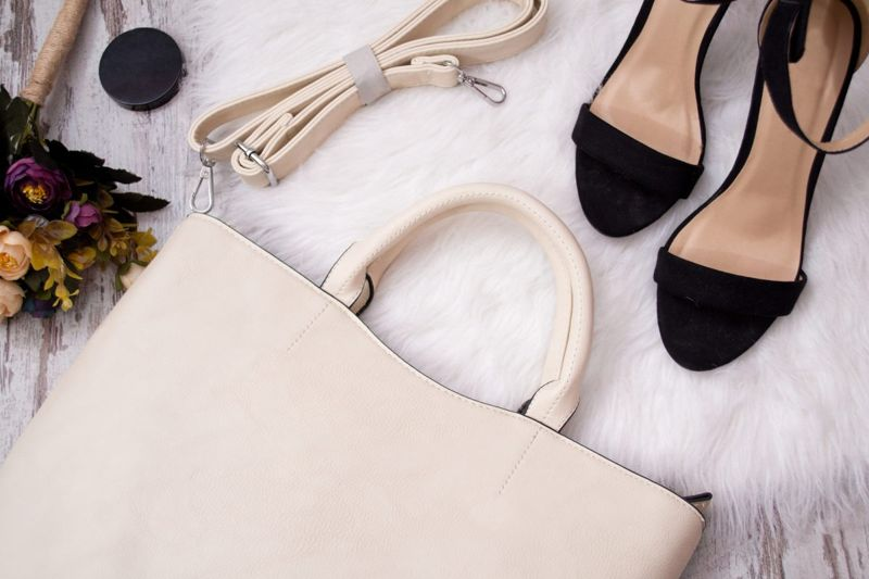 black strappy sandals cream colored purse