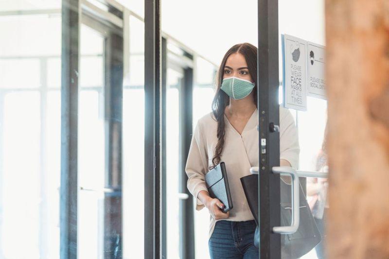 woman leaving university classroom