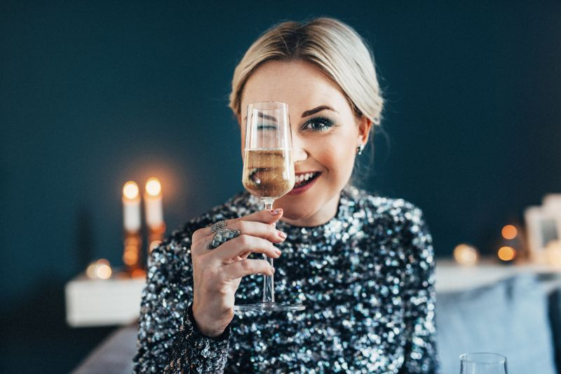 Beautiful woman celebrating new year with champagne