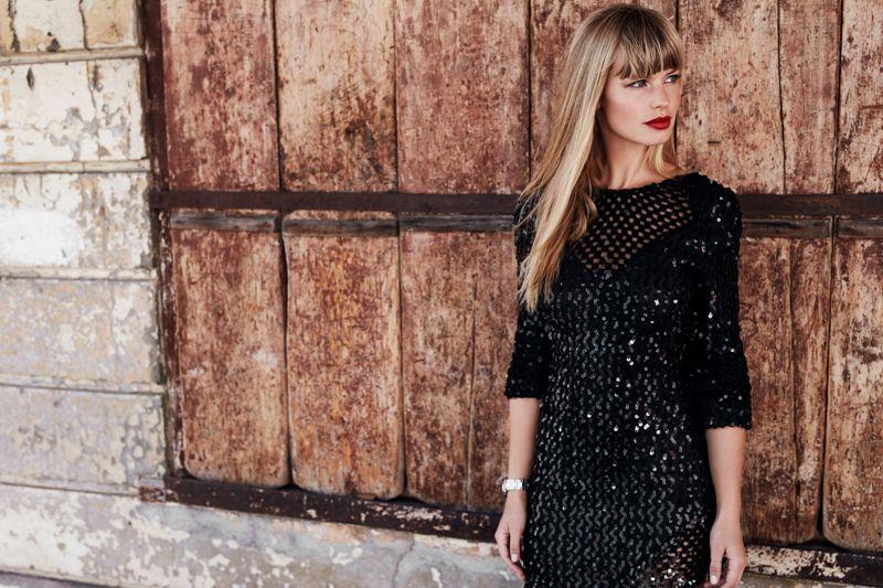 Beautiful woman in black dress, looking away