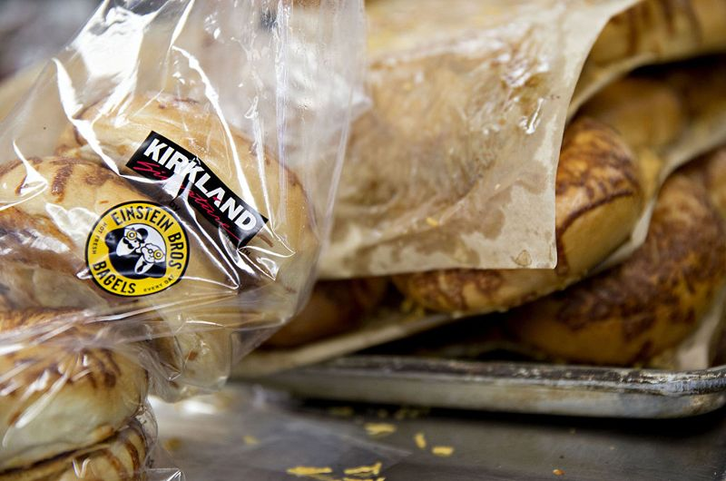 Kirkland store brand bagels sit on a tray at the bakery of a Costco Wholesale Corp. store in Naperville, Illinois, U.S., on Monday, May 23, 2016. Costco Wholesale Corp., the largest U.S. warehouse-club chain, is scheduled to report quarterly earnings figures on May 25.