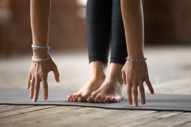 cropped image of forward fold yoga pose asana
