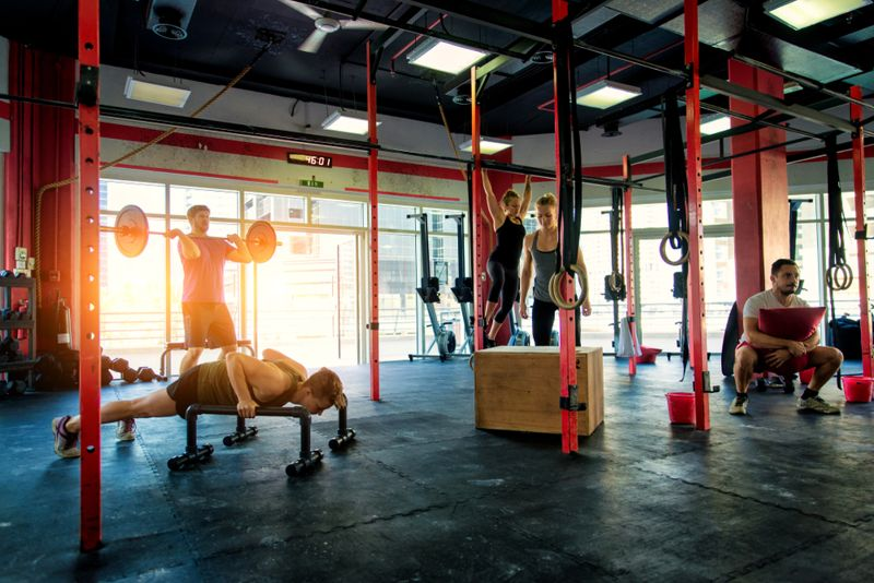 group of athletes doing circuit workout at gym