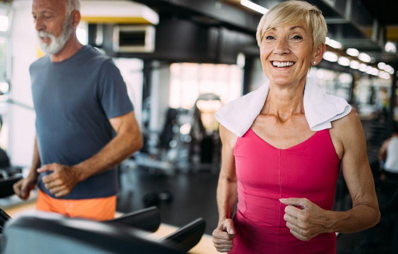 older couple running on treadmills