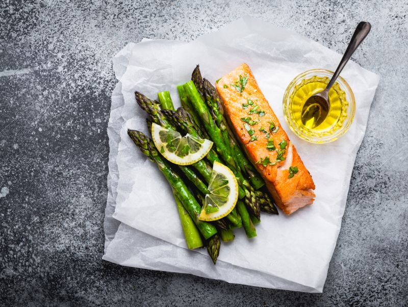 asparagus and salmon on parchment paper