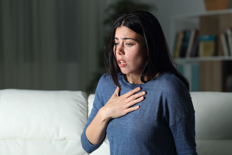 woman having a panic or anxiety attack at home