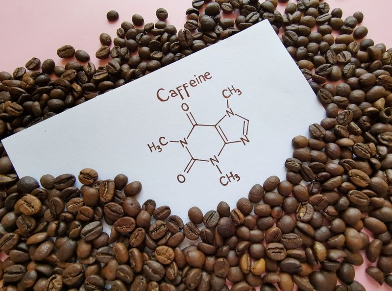 caffeine chemical symbol in pile of coffee beans