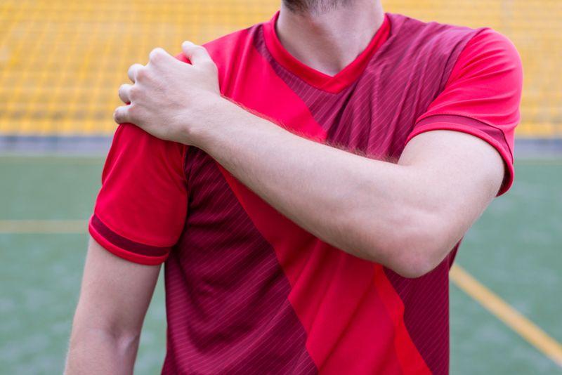 soccer player with injured shoulder