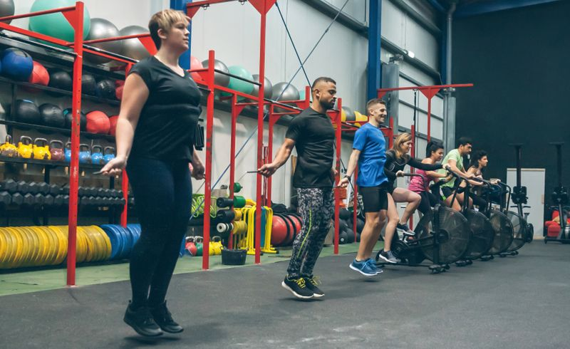 group of people jumping rope at the gym