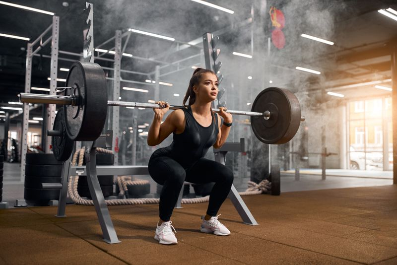 woman lifting a heavy barbell