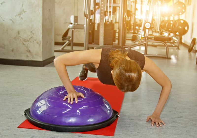 uneven pushup on a bosu ball