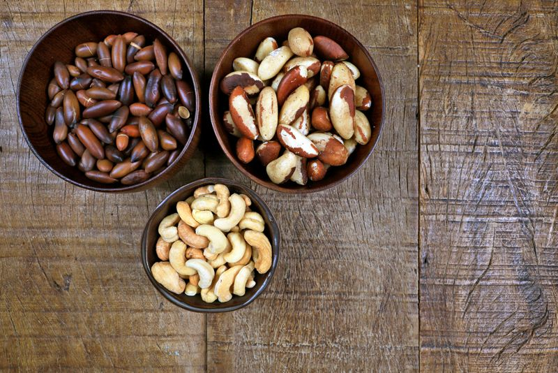 bowls of different nuts including baru nut