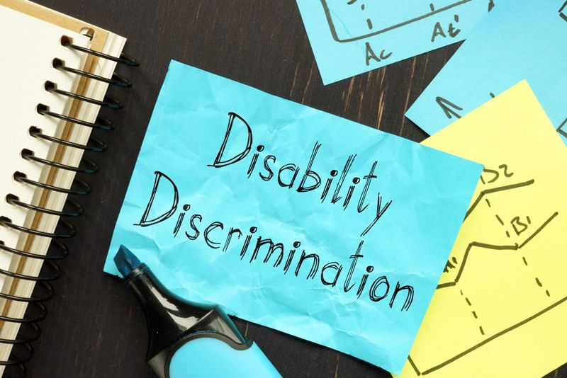 sticky note that says disability discrimination