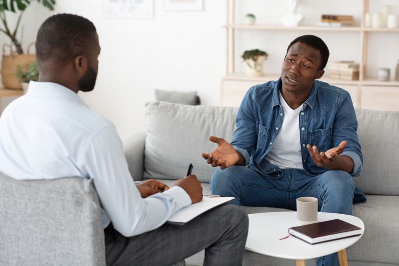 man speaking to a psychiatrist or therapist