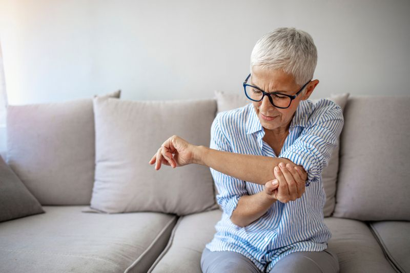women with sore elbow