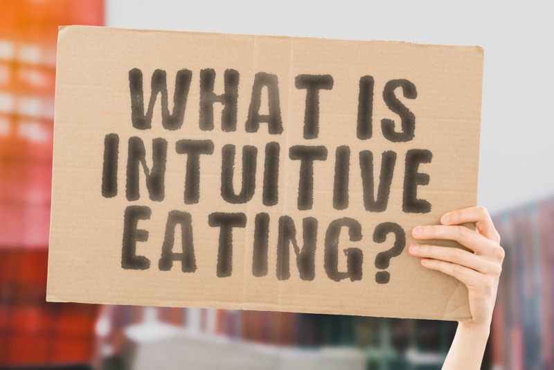 what is intuitive eating cardboard sign