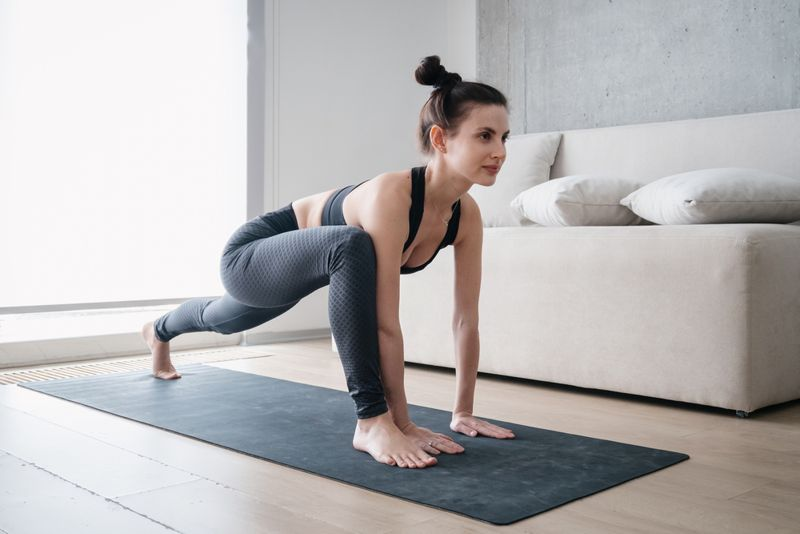 woman doing a lizard stretch or low lunge